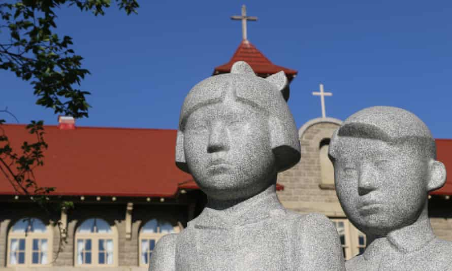 A statue erected to honour all the children who attended Indigenous residential schools, in front of St Eugene's mission school in Cranbook, British Columbia.