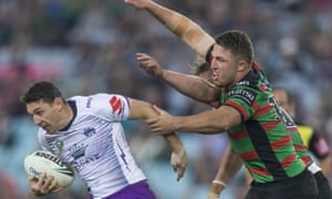 George Burgess and Sam Burgess of the Rabbitohs tackle Billy Slater of the Storm.