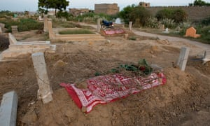 The graves of Ghani Rehman, 17, and Bakhtaja, 15, in Ali Brohi Goth, Karachi