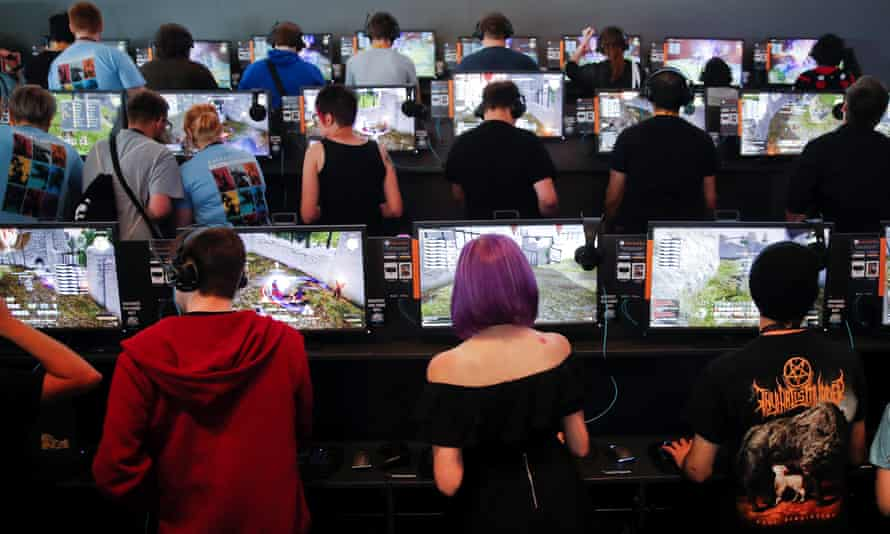 Gamers play video games during the opening Gamescom in Cologne, Germany, August 22, 2017.