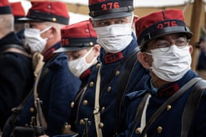 Re-enactors in World War One (WWI) French army uniform wear protective masks on 5 September, as they participate in a two-day event in Meaux, France, to mark the 106th anniversary of the Battle of the Marne. The battle took place in September 1914 and resulted in an allied victory against the German armies in the west.