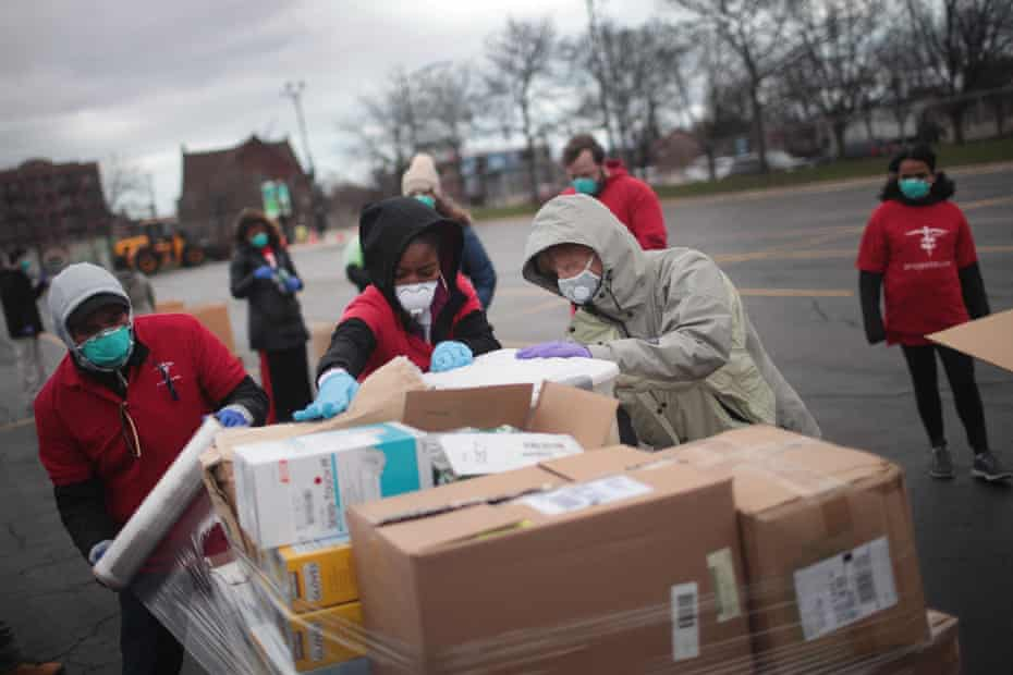 Staff and volunteers with Project C.U.R.E hold a drive outside the United Center to collect donations of personal protective equipment from the community to be used to supply hospitals and clinics that are experiencing shortages due to the Covid-19 pandemic in March in Chicago, Illinois.