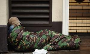 A homeless man sleeps near Trafalgar Square on January 27, 2016 in London, England