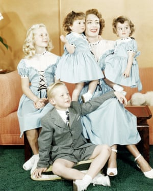 Joan Crawford with Christina, Christopher and her adopted twin daughters, Cindy and Cathy, in 1949.