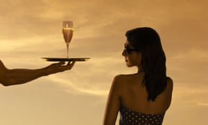 A woman being served champagne