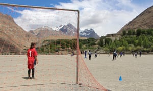 Girls play football on a dusty pitch in Shimshal.