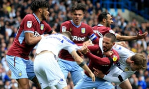 Leeds United's Mateusz Klich is confronted by Aston Villa's Conor Hourihane after he scores his side's first goal.