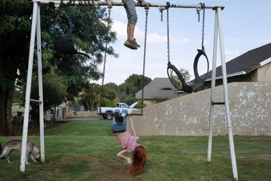 Jonathan and Jeannie play on a swing