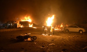 Burning vehicles after bomb blast in Quetta, Pakistan on Sunday.
