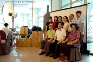 South Korean resident Lee Jae-il (85, front C) and his family, takes a family picture to give his North Korean family.