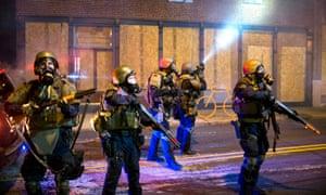 The National Guard on patrol in Ferguson.