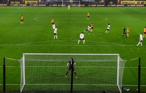 Joao Moutinho of Wolverhampton Wanderers scores a goal to make it 2-1 .