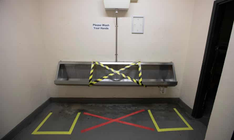 A urinal toilet with floor markings at Ellesmere Port.
