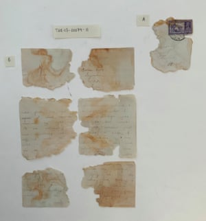Fragments of the love letter and accompanying envelope fragment featuring a stamp and postmark.