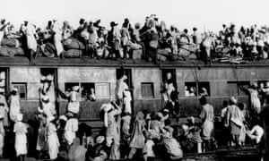 Hundreds of Muslim refugees crowd atop a train leaving New Delhi for Pakistan in this September 1947 .