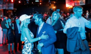 "People dance at the ""A Night for Freedom"" event organized by Mike Cernovich, in Manhattan, New York."