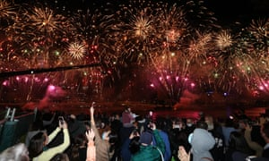 People celebrate in Brisbane after the IOC announcement