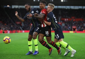 Mario Lemina of Southampton is being blocked by Raheem Sterling and Oleksandr Zinchenko