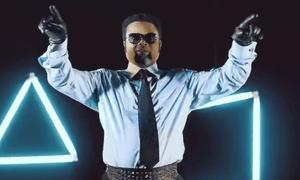 A still from a Felix Wazekwa music video.