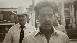 Henry Lee Lucas (center) walking in front of Ranger Phil Ryan (left)