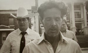We cannot get enough of murder shows ... Henry Lee Lucas (centre) walking in front of Ranger Phil Ryan (left).