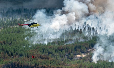 A helicopter battles a wildfire in Khanty-Mansi, Siberia, July 2020.