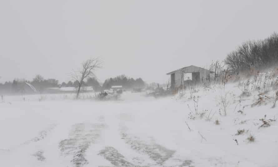 Snow covers farm buildings on a Minnesota dairy farm