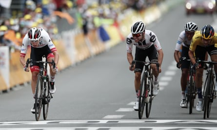 Tadej Pogacar (left) denies Marc Hirschi at the line to win stage nine.