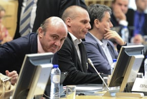 Spanish Economy minister Cristobal Montoro Romero (L) and Greek Finance Minister Yanis Varoufakis (C) attend a Eurogroup Council meeting on June 24, 2015 at the EU Headquarters in Brussels. AFP PHOTO / JOHN THYSJOHN THYS/AFP/Getty Images