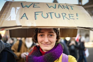 A protester gets her message across at the student climate march in George Square, Glasgow