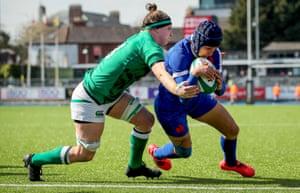France's Caroline Boujard goes over despite the best efforts of Ireland's Ciara Griffin.