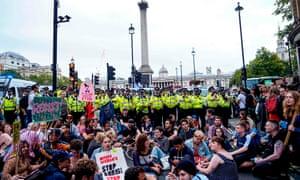 'Stop the Coup' demonstrators block the road near Trafalgar Square on Saturday