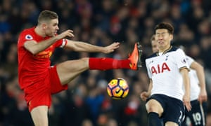 Liverpool's Jordan Henderson in action with Tottenham's Son Heung-min.