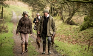 Members of the Bowland Shoot in the Trough of Bowland, Lancashire, carrying dead pheasants