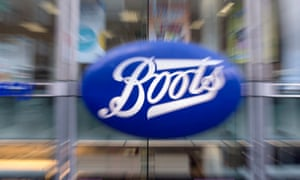 The sign for a branch of Boots the chemist on Oxford Street.