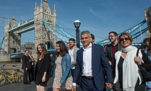 Sadiq Khan arrives at City Hall with his wife Saadiya (right) and campaign team
