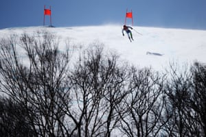 Martin Cater of Slovenia clears the jump during the men's alpine combined downhill.