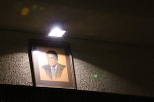 A portrait of Robert Mugabe hangs on the wall at the Zanu-PF committee meeting