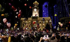 People release balloons as they gather to celebrate the arrival of the new year in Wuhan, China