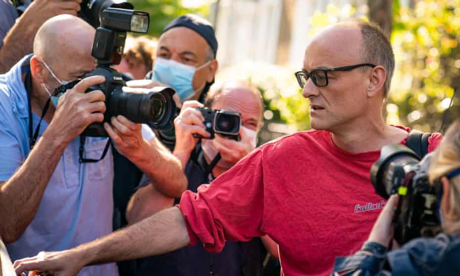 Dominic Cummings leaves his north London home surrounded by photographers after the story broke.