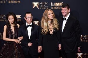 Lawrence Ho and his wife, Sharen Lo Shau Yan, with Mariah Carey and James Packer at the opening ceremony of the Studio City casino in Macau