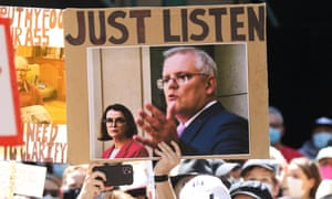 A sign at a women's march reads 'Just listen' with a photo of Scott Morrison