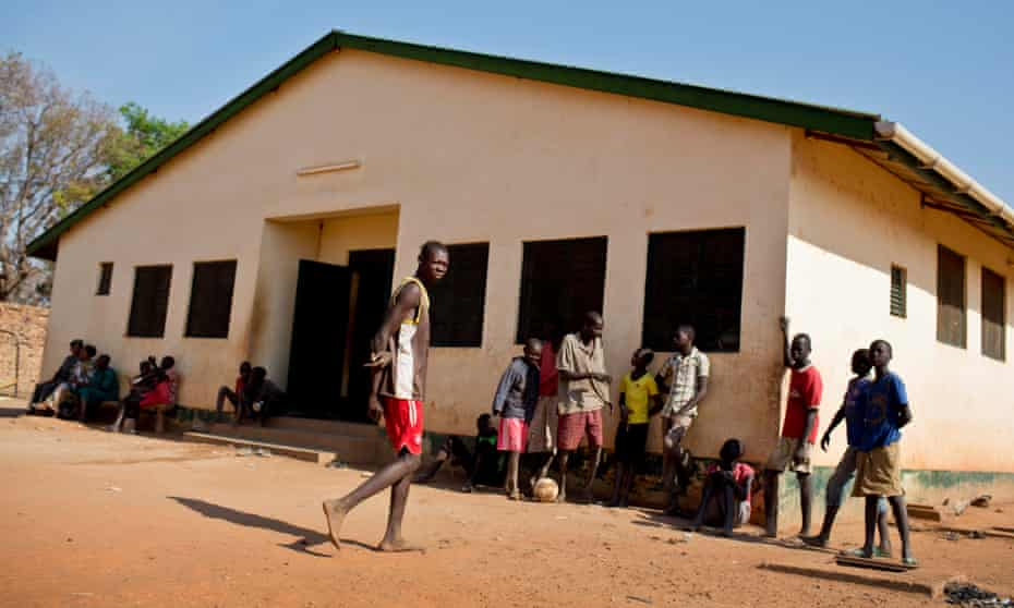 Young boys outside the accommodation block of the Wau juvenile facility for young offenders, South Sudan