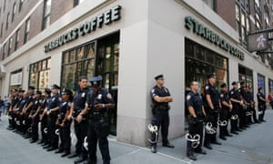 Police officers outside a New York branch of Starbucks in 2004.