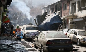 The aftermath of a suicide car bomb blast in central Kabul that killed 40 people recently.