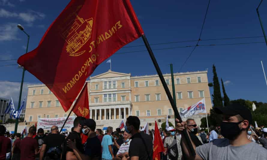 Opponents of the government's labour law reforms demonstrate outside parliament in Athens