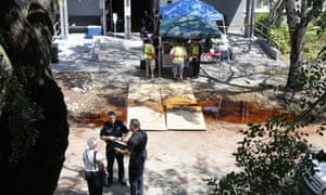 Police officers talk to an employee at the Rehabilitation Center at Hollywood Hills in Hollywood, Florida, where eight residents died in Hurricane Irma's aftermath, authorities said Wednesday.