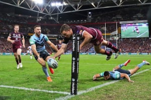 Corey Oates of the Queensland Maroons scores a try during game one of the 2019 State of Origin series against the New South Wales Blues in Brisbane