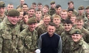 Tommy Robinson surrounded by British army soldiers, an image taken from his own account.