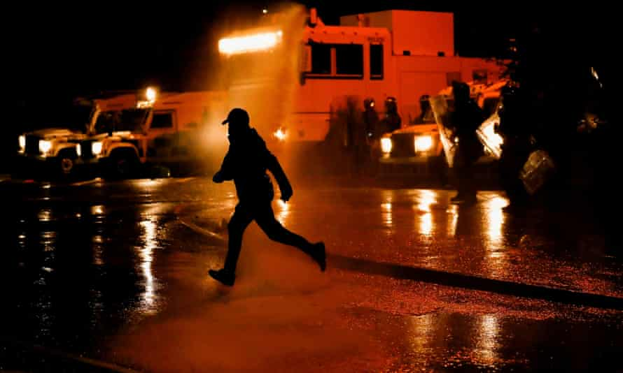 Police use water cannon during protests in Belfast, Northern Ireland, 8 April 2021